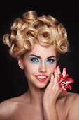 Vintage style portrait of young beautiful blonde woman with fancy makeup and prom hairdo poster
