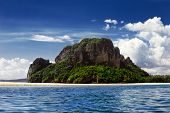 stock photo of deserted island  - Tropical South East Asian Island bright blue sky - JPG