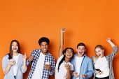 Excited Friends With Phones Screaming And Celebrating Success Over Orange Background, Copy Space poster