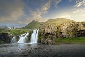 Sunset At A Waterfall Near The Kirkjufell Mountain In The East Of Iceland poster