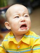 stock photo of pouty lips  - crying baby - JPG