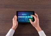 Hand touching tablet with waveforms and sound design concept poster