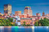 Manchester, New Hampshire, USA Skyline on the Merrimack River at dusk. poster