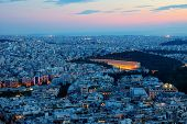 stock photo of olympic stadium construction  - View over Athens at dawn with the old olympic stadium - JPG