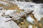 stock photo of samaria  - Wooden bridge passing at Samaria gorge of Crete island in Greece - JPG