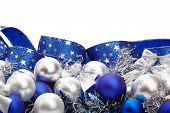 pic of christmas cards  - Silver and blue Christmas decorations and tree adornments on white background with copy space above - JPG