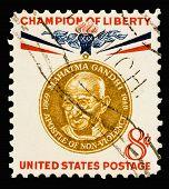 stock photo of mahatma gandhi  - A 1961 issued 8 cent United States postage stamp showing Champion of Liberty Mahatma Gandhi - JPG