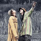Young rastafarian man and woman on nature