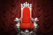 stock photo of throne  - Ornate red velvet throne on velvet backdrop - JPG