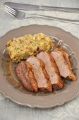 pic of duck breast  - Roasted Duck Breast with dumplings on a plate - JPG