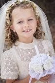 stock photo of eucharist  - A young child doing her first holy communion - JPG