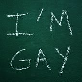 image of gay symbol  - sentence I am gay written in a chalkboard - JPG