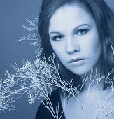 foto of cold-shoulder  - Young woman with winter twig - JPG