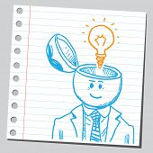 Businessman open headed with lightbulb (idea concept)