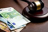 stock photo of bill-of-rights  - judge gavel with euro bills on wooden background - JPG