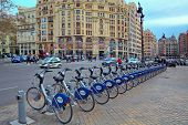 VALENCIA, SPAIN - JANUARY 14, 2014: City square and Valenbisi station - public bicycle rental statio