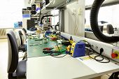 pic of pliers  - electronics equipment assembly workplace with pliers and necessary tools - JPG
