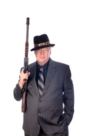 stock photo of sub-machine-gun  - Gangster or FBI agent with sub - JPG