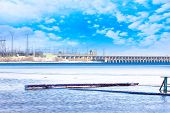 pic of hydroelectric  - hydraulic structure hydroelectric power station on the winter river - JPG