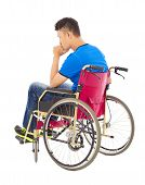 stock photo of handicap  - handicapped man sitting on a wheelchair and thinking - JPG