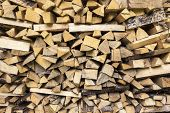 image of firewood  - Some firewood and an axe for making new firewood - JPG