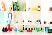 picture of liquids  - Different laboratory glassware with color liquid on laboratory background - JPG
