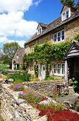 picture of slaughter  - Pretty stone cottages in the centre of the village Lower Slaughter Cotswolds Gloucestershire England UK Western Europe - JPG