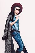 image of coat  - Glamorous fashion model in coat and stylish jeans clothes - JPG