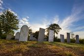 pic of tombstone  - Tombstones sit quietly in an old cemetery in New England - JPG