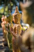 foto of buddhist  - Clay praying women statue in the buddhist temple in Thailand - JPG