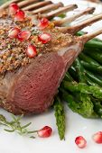 pic of crust  - Herb crusted rack of lamb garnished with asparagus green grapes and pomegranates - JPG