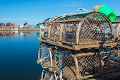 picture of lobster boat  - Old style lobster traps on a wharf if rural Prince Edward Island - JPG