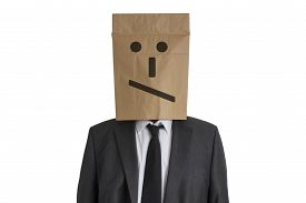 stock photo of disappointed  - A Man in suit with a paper bag with disappointed smiley on his head isolated on white background - JPG