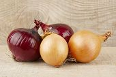pic of onion  - Onions and red onions on wooden background plank - JPG