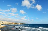 pic of windy  - Alghero rocky coast on a windy day with clouds - JPG
