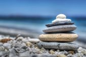 foto of piles  - stones pile on white pebbles by the shore - JPG