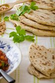 pic of chickpea  - Lebanese bread pita bread nice and fresh chickpeas in background simple cheap bread with herbs and garlic - JPG