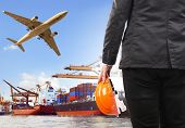 foto of export  - working man and commercial ship on port and air cargo plane flying above use for water and air transportlogistic import export industry - JPG