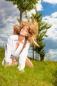 stock photo of windy  - female windy hair in park  - JPG