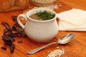 foto of porridge  - dried mushrooms and porridge soup in a porcelain pot - JPG