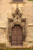 stock photo of entryway  - secondary entrance of old gothic church detail on stone carved elements - JPG