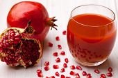 image of pomegranate  - Glass of pomegranate juice with fresh pomegranate fruits - JPG