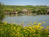stock photo of yellow castle  - Scenic ruins of an ancient castle on the river shore Les Andeles France - JPG
