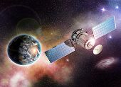 stock photo of outer  - satellite orbiting the earth in the outer space - JPG