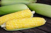 stock photo of sweet-corn  - Peel sweet corn with wood table background - JPG