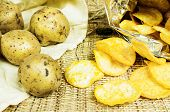 image of potato chips  - Natural potato chips in a package and potatoes in the bag - JPG