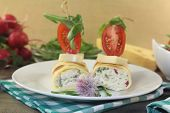 stock photo of crepes  - stuffed cheese crepe rolls with tomatoes and arugula - JPG
