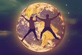 picture of twinkle  - Couple jumping and holding hands against stars twinkling in night sky - JPG