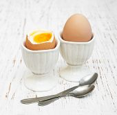 foto of boil  - boiled eggs for breakfast on a old wooden table - JPG