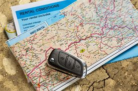 stock photo of rental agreement  - Car remote key on map and rental agreement - JPG